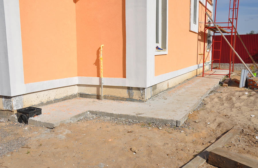 under construction house with water pipe outiside